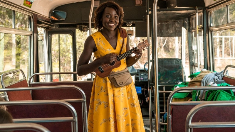 lupita-singing-on-bus-little-monsters.jpg
